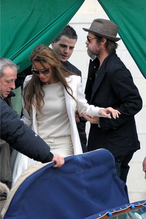 Brad Pitt and Angelina Jolie are pictured here visiting Johnny Depp at his
