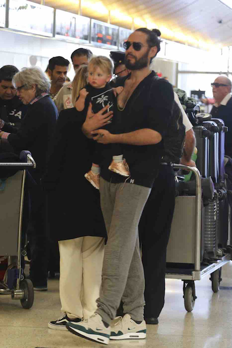 Here's a sight we never thought we'd see: Russell Brand carrying his own  rosy-cheeked baby girl named Mabel. What would Katy Perry think?
