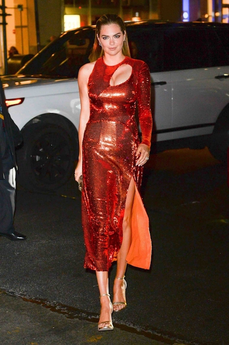 Kate Upton couldn't be happier as she walks into the Sports Illustrated  party in New York. After she accused Moroccan-born Guess co-founder Paul  Marciano of ...