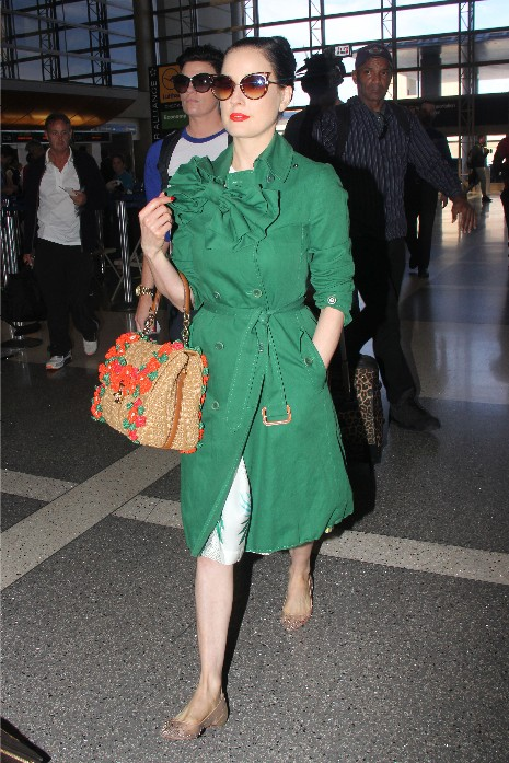 I GET DITA DEPARTING TOM BRADLEY IN HER MONET GREEN.