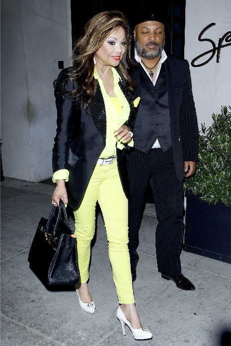 latoya jackson dines at spaggo in neon green