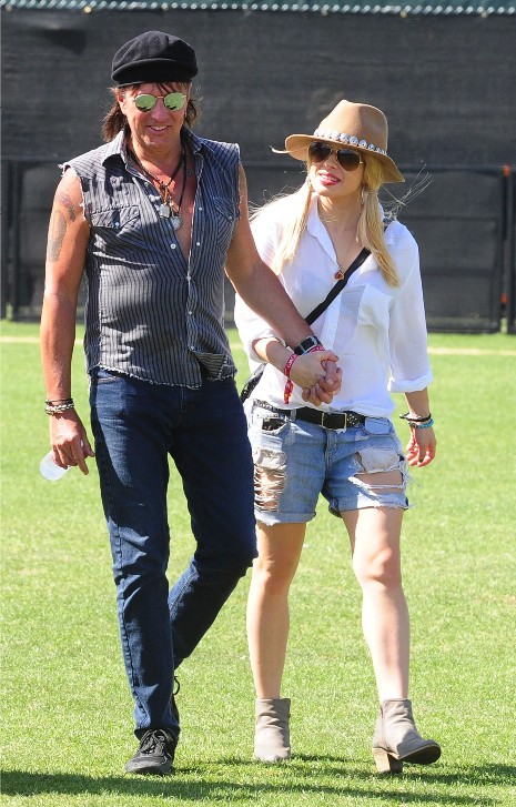 Richie Sambora and his wife holds hands at Coachella.