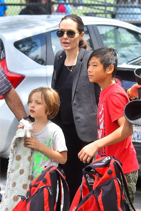 Angelina Jolie heads to her kid's soccer game.