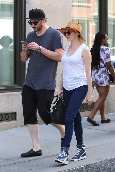 rose Mcgowan and husband  davey detailas they walk in tribeca monday afternoon.