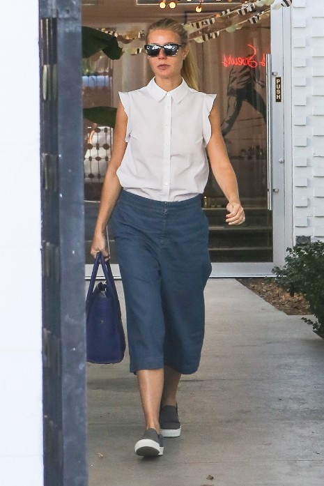 gwenyth paltrow wearing long jean skirt and white blouse top