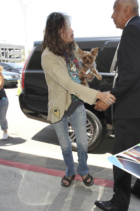 Aerosmith frontman Steven Tyler shows off his feet in a pair of sandals as he was spotted departing from LAX airport